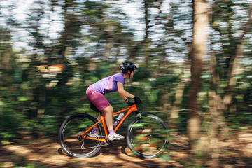Female mountain bike rider in motion