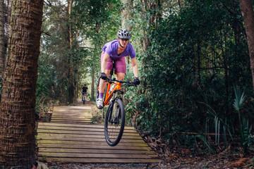 Female cyclist on a jump