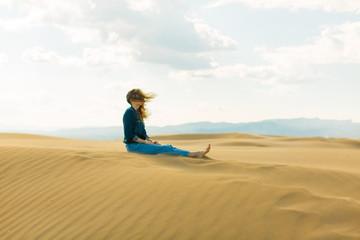 Woman enjoying on the sand