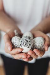 Man holding Easter eggs