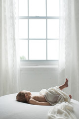 Baby Stretching In Front of Window