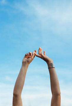 Arms woman raised to sky