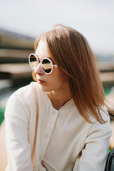 Portrait of a caucasian beauty girl in sunglasses