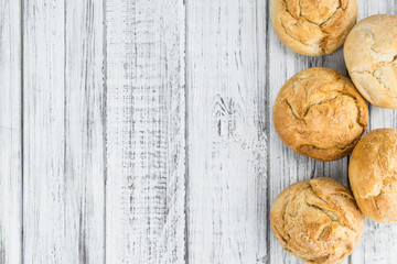 Fresh made Rolls (German style) on a rustic background
