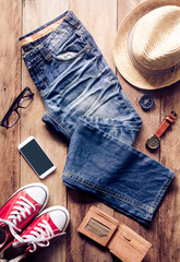 Clothing and accessories for travel on wooden floor - concept lifestyle