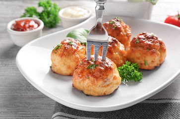 Fork with delicious meatball on plate