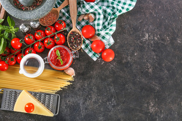 Composition with tasty tomato sauce for pasta on table