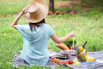 Deurstickers Picknick Woman on picnic in park