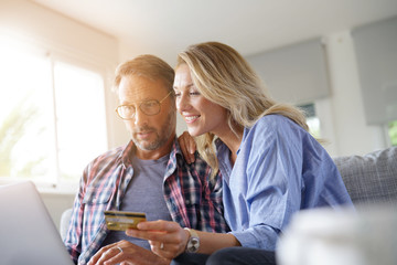Mature couple buying on internet, online shopping