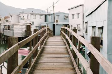 Wooden bridge with old floating home in Tai o fishing village, HongKong