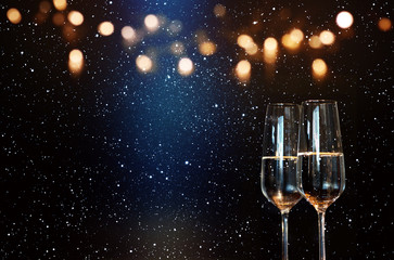 Champagne with blue spotlight and golden bokeh
