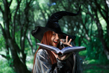 Photo of young witch with book