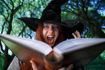 Picture of witch with open magic book