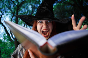 Close-up photo of screaming witch