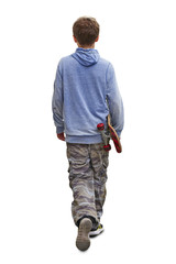 Young boy teenager walking with his skateboard isolated