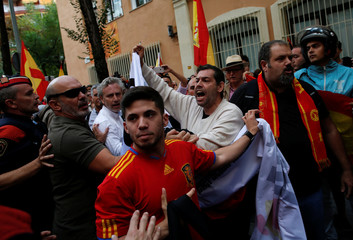 A demonstrator shoutrs during a gathering in support of Spanish civil guards outside their barracks in Barcelona