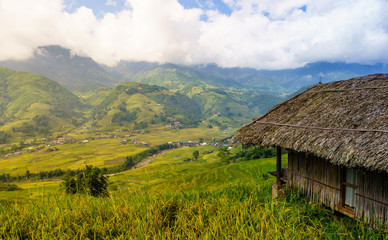 A small wooden cottage at the terrace rice field