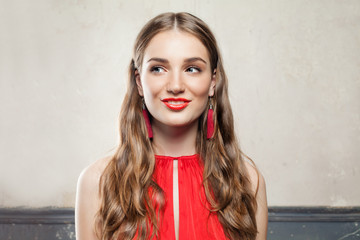 Beautiful Surprised Fashion Model Woman with Makeup Wearing Red Cloth