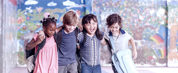 Multi ethnic group of children playing together. Success and integration concept