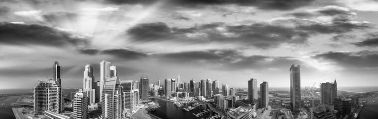 Aerial panoramic black and white view of Dubai Marina skyscrapers