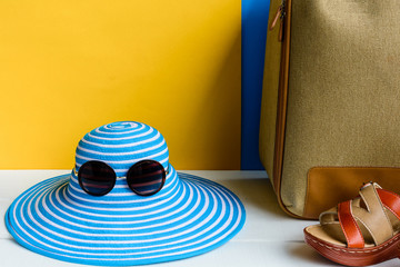 set travel and vacation with Blue hat sunglasses and bag orange shoe