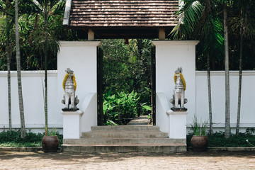 Concrete wall and wooden doors decorative with Thai lion sculpture Resort decoration