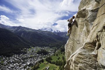 Man climbing via ferrata above Zermatt