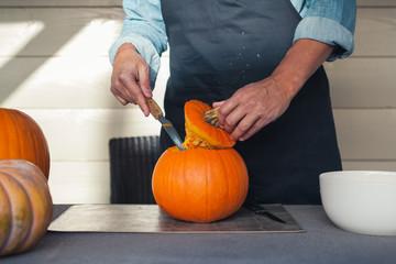 Cutting a pumpkin for halloween