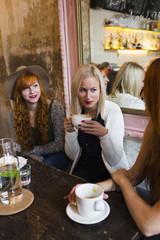 Female friends having breakfast at cafe