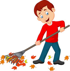 Happy boy raking leaves