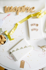 Presents and wrapping papers and ribbons