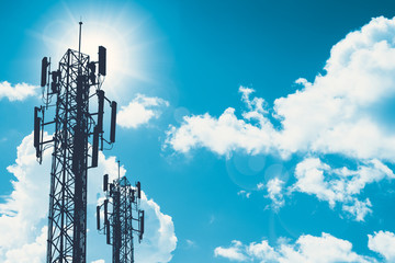 communication tower or 3G 4G network telephone cellsite silhouette on blue sky and space for text Wall mural