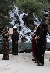 Tourists take pictures of each other at the Bekhal Waterfall in Erbil