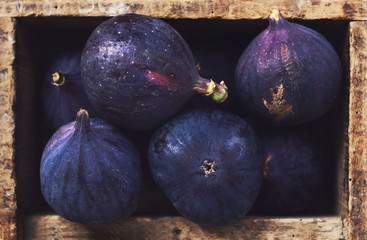 Ripe figs in rustic wooden crate