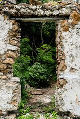 Door in stone wall of abandoned building
