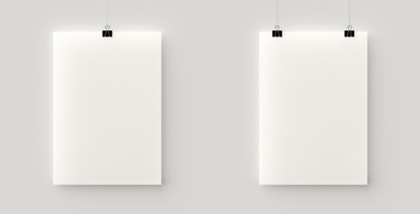 Set of 2 blank posters hanging on a thread with black clips