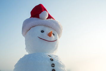 santa claus snowman in red hat.