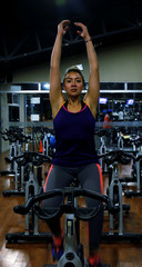"""A woman works out on a gym bike during a training session at the """"Spazio"""" fitness centre in La Paz"""