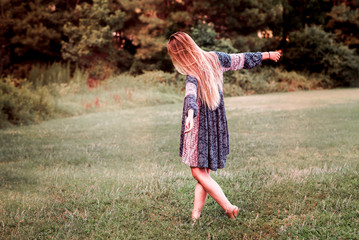 Woman Free-Spirit Bohemian Hippy Dancing in Nature