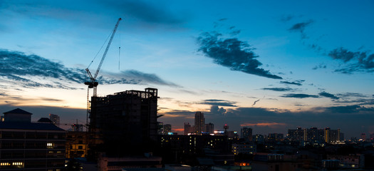 Silhouette picture of  of construction crane with atmosphere of City atmosphere