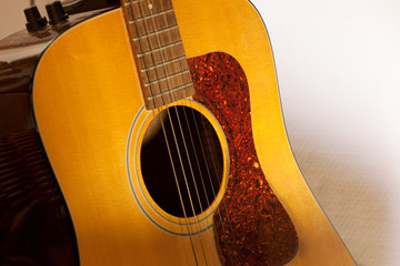 detail of vintage western guitar body with sound hole