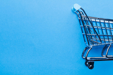 Shopping cart on a blue background
