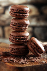 Foto auf Leinwand Macarons macarons sweet chocolate macaron French on wooden table