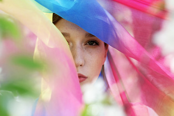Part of the face covered with colored scarf