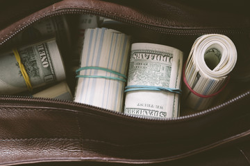 leather bag with cash