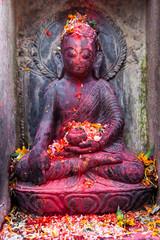 Vermillion covered gods on the streets of Kathmandu.