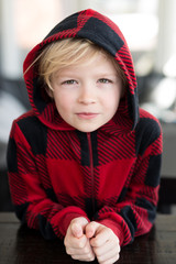 Portrait of Mischievous Blonde Little Boy With Messy Hair
