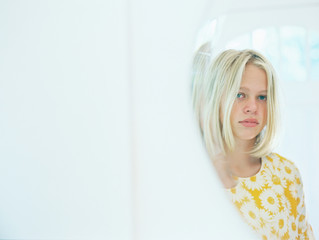 mirror reflection of blonde girl teen with white
