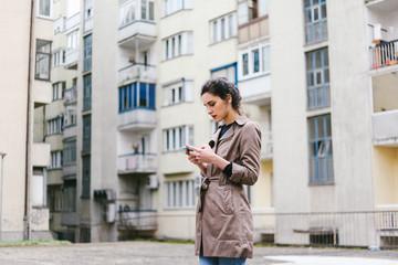 Stylish woman holding a smart phone