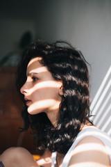 Portrait of a brunette woman indoor